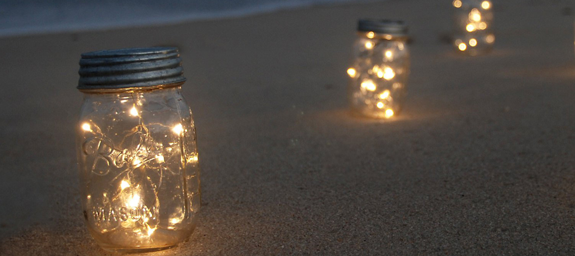 Mason jar fairy lights on beach